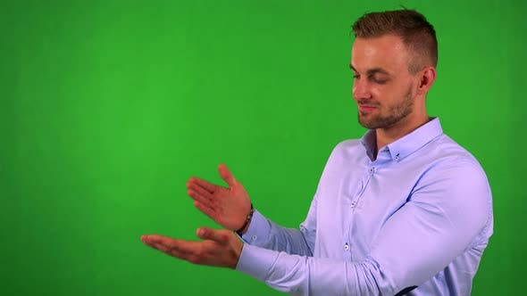 Thumbnail for Young Handsome Business Man Introduces Something - Green Screen - Studio