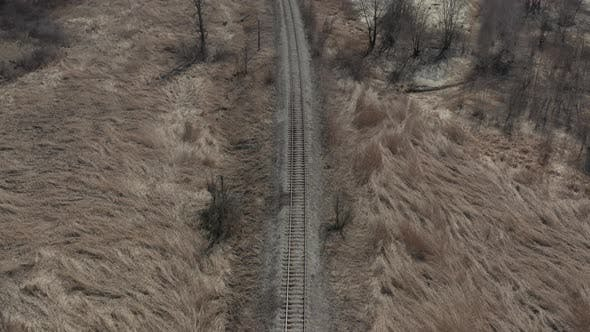 Thumbnail for Railway line in the field with dry plants 4K aerial video