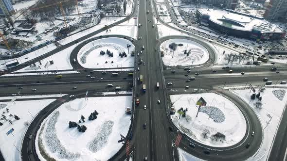 Thumbnail for Car Driving on Flyover Highway Winter City. Aerial View Overpass Freeway in City