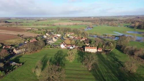 Aerial footage of the British country side fields in the winter time in the UK