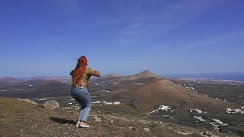 Woman Hiker Jumps Up on Mountain Top Slow Motion