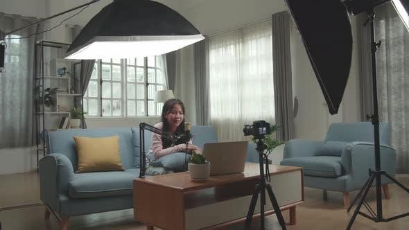 Asian Girl Vlogger Sing A Song. Professional Light Equipment