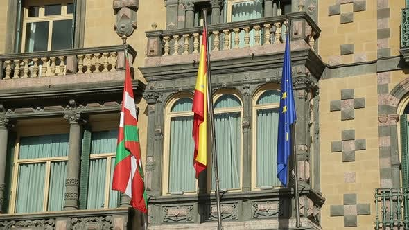 Thumbnail for Flags of EU, Spain and Basque Country Waving on Government Building Facade