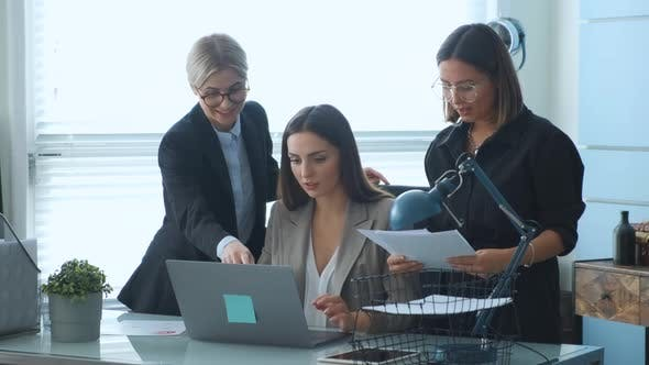 Confident young businesswoman presenting new business project to partners in modern office