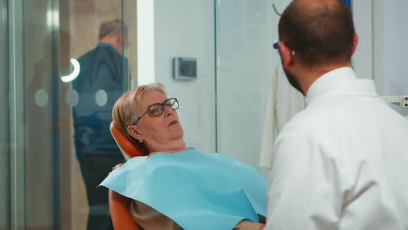 Close Up of Patient Talking with Stomatologist