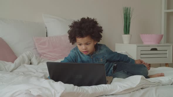 Cover Image for Multiethnic Boy Watching Video Online Using Laptop