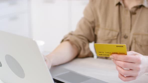 Thumbnail for Unrecognizable Woman Shopping Online with Credit Card and Laptop