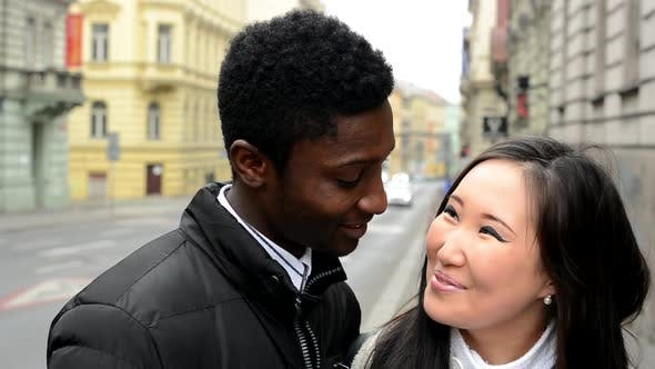Thumbnail for Happy Couple Smile To Camera - Black Man and Asian Woman - Urban Street with Car - Closeup