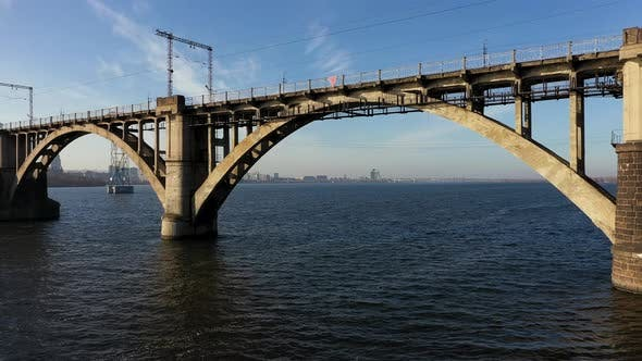 Thumbnail for Aerial View Under the Old Arch Railway Bridge in Dnipro City