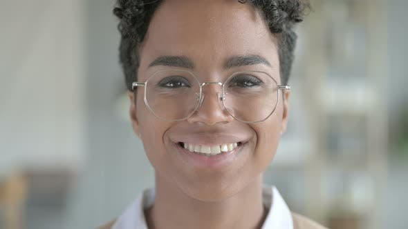 Portrait of Smiling Young African Girl with Glasses