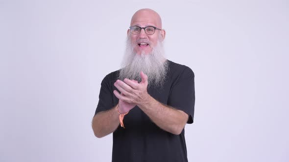 Thumbnail for Happy Mature Bald Bearded Man Clapping Hands