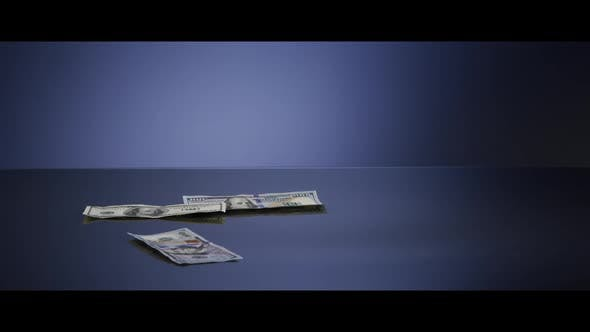 American $100 Bills Falling onto a Reflective Surface - MONEY 0041