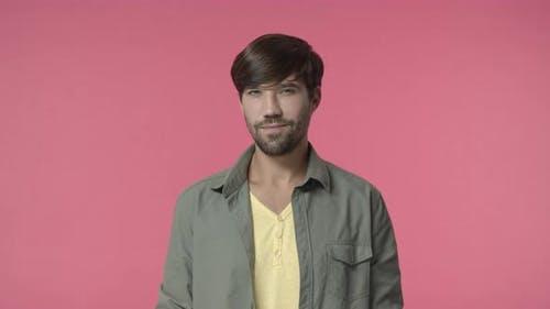 Charismatic Handsome Cheeky Hispanic Bearded Guy Hinting on Something Flirting Smirk and Squinting