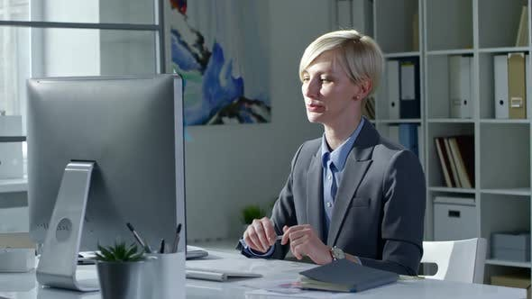 Thumbnail for Blonde Business Lady Video Conferencing on Computer
