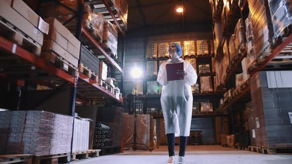 Thumbnail for Controller Checking Factory Storage Room. Candy Factory.