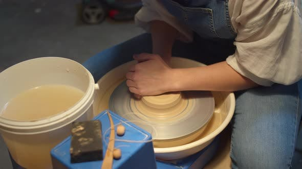 Thumbnail for Potter Applies Force To Shape Clay