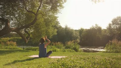 Practicing yoga in park