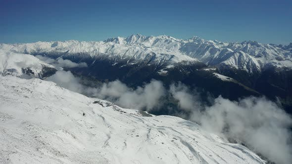 Thumbnail for Aerial View of a Forest Covered with Fresh Snow and Clouds in the Aletsch Arena Area. Switzerland in