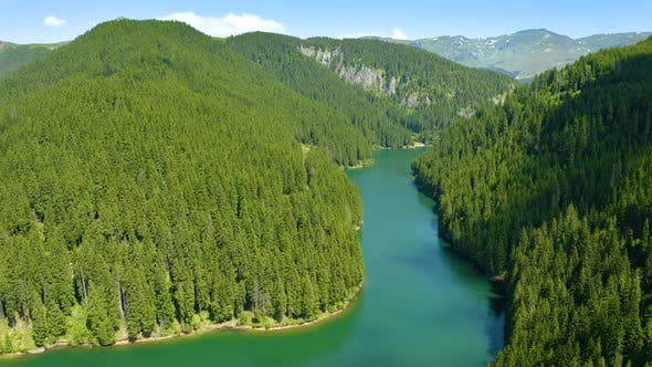 Aerial view of blue lake and green forests. Fresh water. Lake Baikal