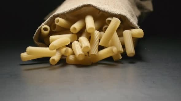Thumbnail for Cloth bag falls and pasta (tortiglioni) fall out of him