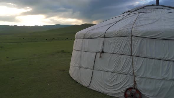 A White Ger in The Meadows of Mongolia at Sunrise