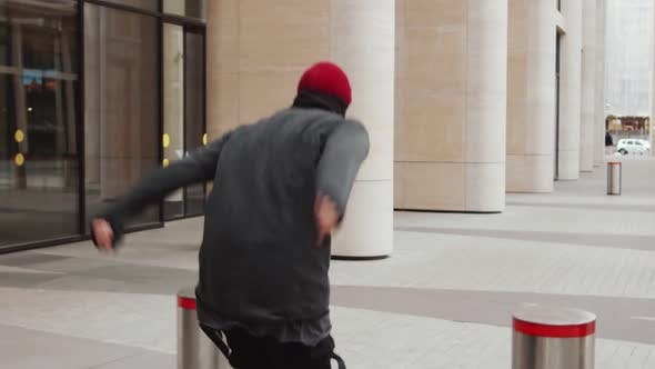 Thumbnail for Young Male Athlete Performing Parkour Tricks in Slow Motion