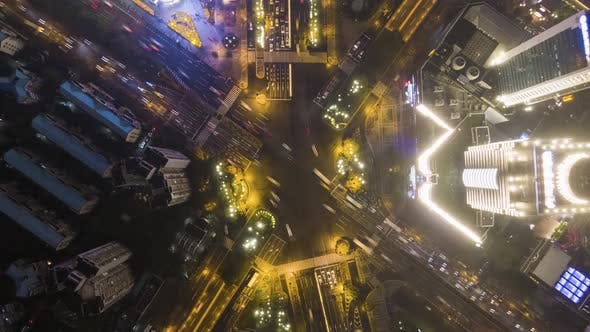 Cover Image for Complex Road Intersection in Shanghai, China at Night. Aerial Vertical Top-Down View