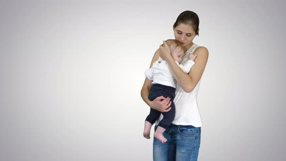 Thumbnail for Young Mother Trying To Calm Down Infant Son, Alpha Channel