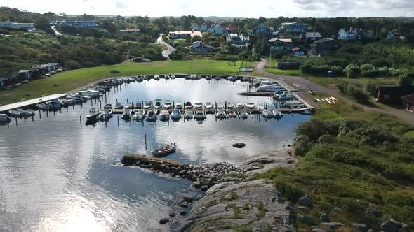 Thumbnail for Aerial Drone Shot of A Small Marina at The Ocean Coastline