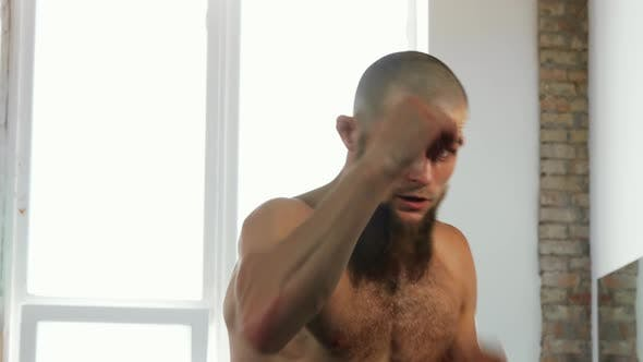 Bearded Professional Male Kickboxer Shadowboxing at Sports Studio