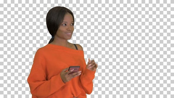 Cover Image for Beautiful afro woman using smart phone, Alpha Channel