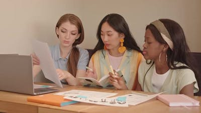 Female Designers Working on Fashion Sketches