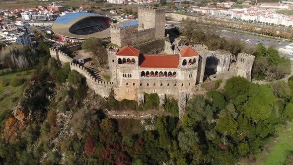 Thumbnail for Flying Over Medieval Castle With Modern Stadium in the Background