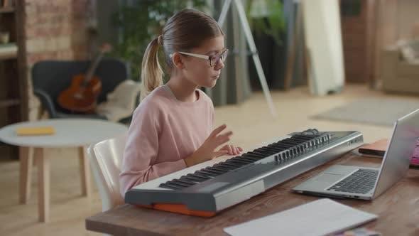 Thumbnail for Girl Having Online Music Lesson