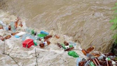 Plastic garbage in the river. Huge pile of plastic garbage