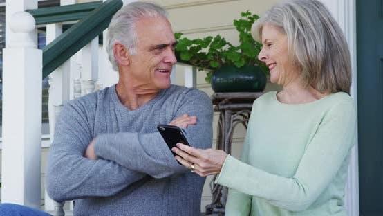 Thumbnail for Senior couple using social media on smartphone