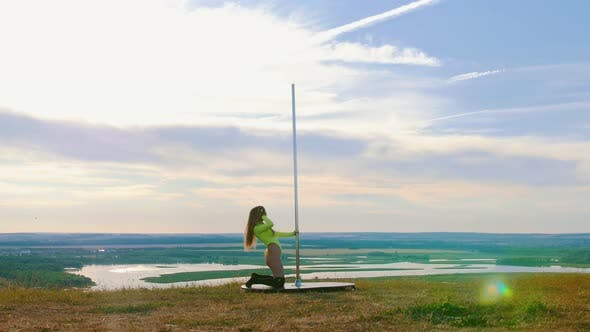 Thumbnail for Pole Dance on Nature - Sexy Woman in Green Swimsuit Dancing By the Pole