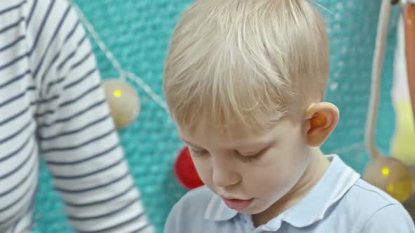 Thumbnail for Cute Boy Playing with Colorful Dough and Talking to Mom