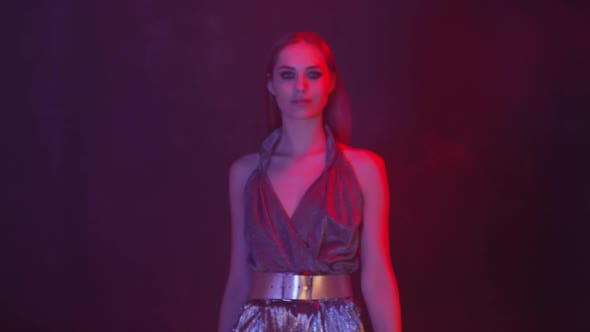 Thumbnail for Stunning Fashion Model in Gorgeous Outfit Posing in Neon Light