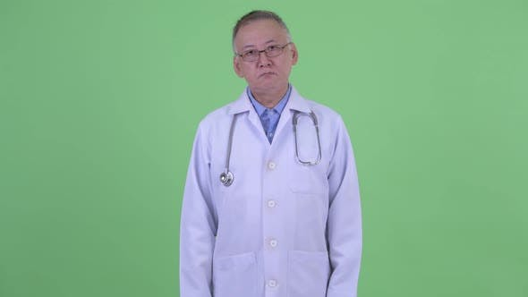 Thumbnail for Mature Japanese Man Doctor with Eyeglasses