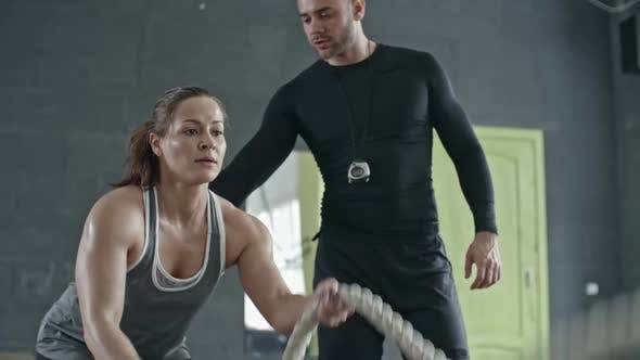 Thumbnail for Female Athlete Doing Battle Rope Exercise with Coach