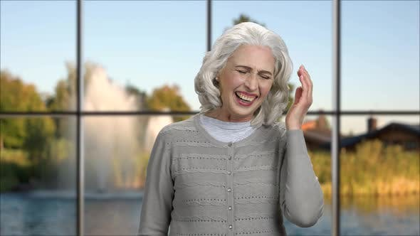 Cheerful Mature Woman Can Not Stop Laughing.
