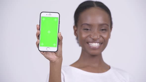 Thumbnail for Face of Happy Young Beautiful African Woman Showing Phone