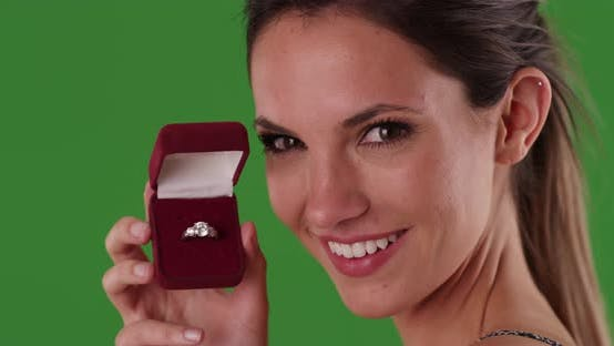 Thumbnail for Smiling woman holding diamond engagement ring in jewelry box on greenscreen