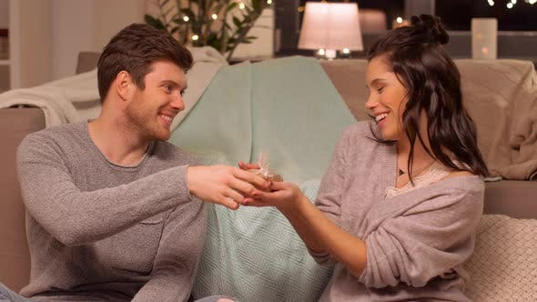 Thumbnail for Happy Couple with Gift Box at Home