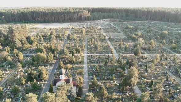 Cemetery with graves. Drone flying over old cemetery at sunrise.
