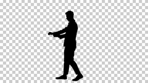 Silhouette Young cool elegant man walking by, Alpha Channel