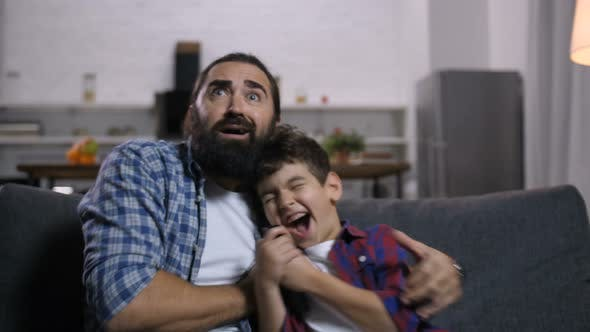 Thumbnail for Terrified Father and Son Watching Horror Movie