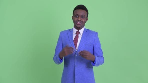 Thumbnail for Happy Young African Businessman Explaining Something