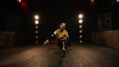 Young Brunette Dancing Break Dance In Studio.